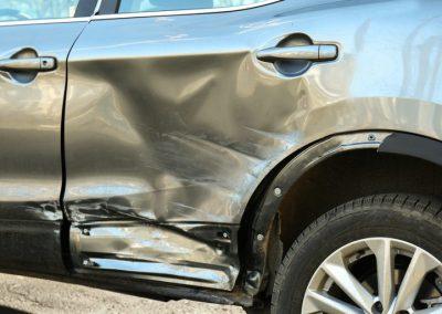 Damaged-car-on-the-street-170711597-768x512